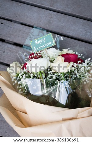 Happy anniversary red and white rose bouquet