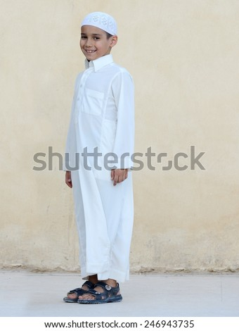 Happy Arabic boy jumping - stock photo