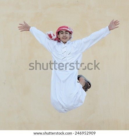 Happy Arabic boy jumping - stock photo
