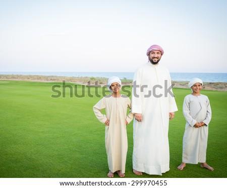 Happy Arabic family on summer vacation - stock photo