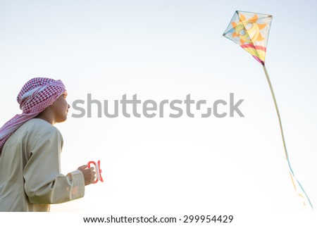 Happy Arabic kid with kite - stock photo