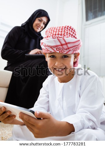 Happy Arabic mother and son together at home.