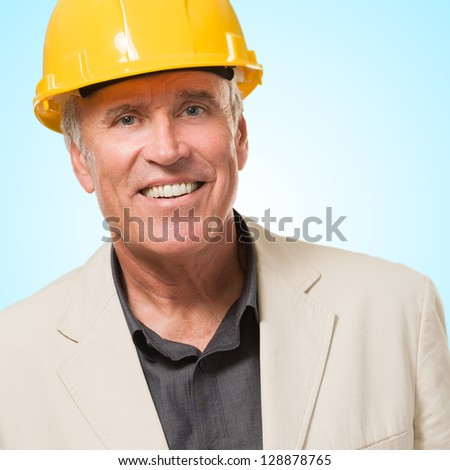 Happy Architect Man Smiling against a blue background - stock photo