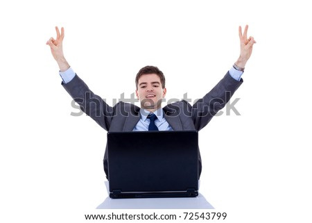 Happy arm rising winning business man, screaming at his desk - stock photo