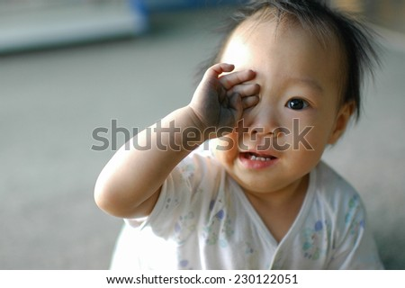 Happy Asian baby with diry hand. - stock photo