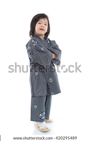 Happy asian boy in kimono standing on white background isolated - stock photo