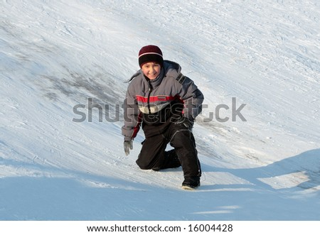 happy asian boy on hill in bright winter day - stock photo