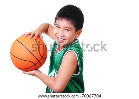happy asian boy playing basketball - stock photo
