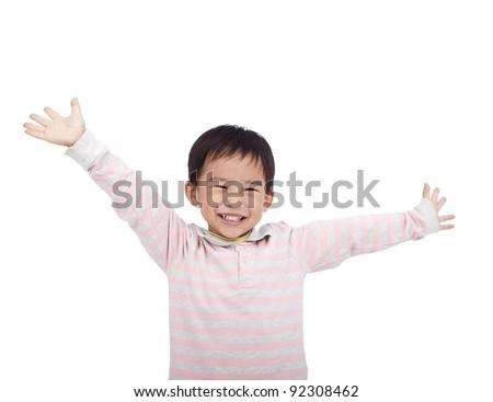 happy asian boy raising hand - stock photo
