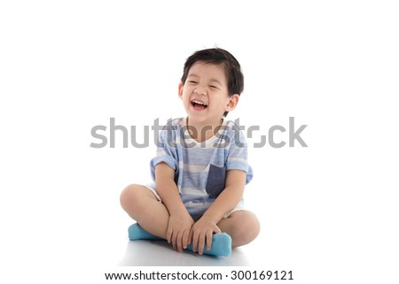 Happy asian boy sitting on white background isolated - stock photo