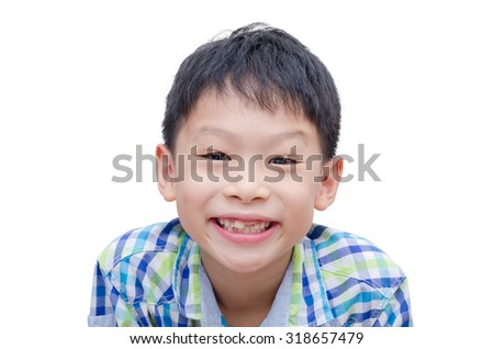 Happy Asian boy toothless smile close-up,new teeth rising over white background - stock photo