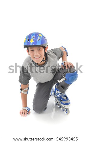 Happy Asian boy wearing safety guard for playing roller blades on white.