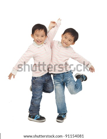 happy asian boys dancing together - stock photo
