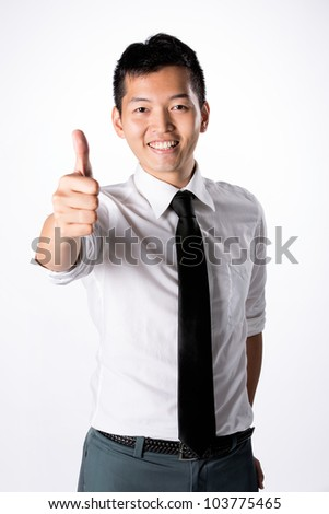 Happy Asian business man with thumbs up. - stock photo