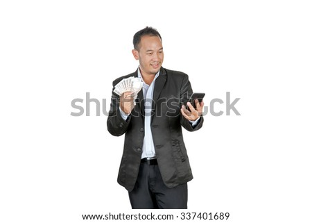 happy asian businessmen holding banknotes and looking at his cellphone, isolated on white - stock photo