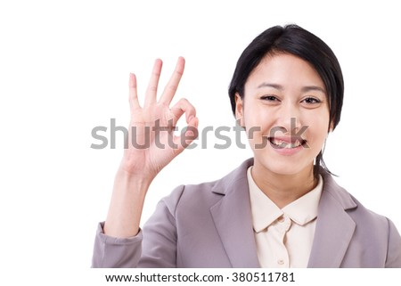 happy asian caucasian business woman giving ok hand gesture - stock photo