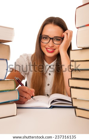Happy asian caucasian girl learning in study with lots of books on the table isolated - stock photo