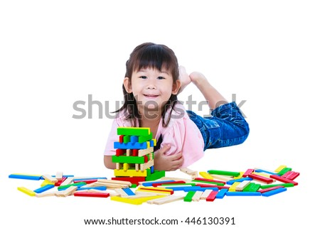 Happy asian child looking at camera. Pretty girl playing toy wood blocks, isolated on white background. Educational toys for kindergarten child. Strengthen the imagination of child. Studio shot.