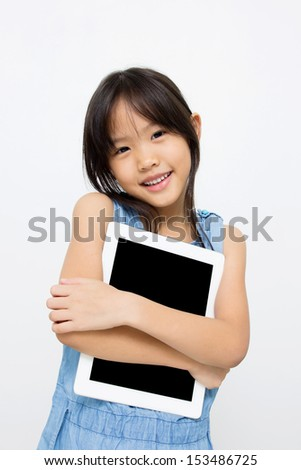 Happy Asian child with tablet computer - stock photo