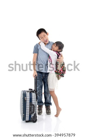 Happy Asian children hoding together with suitcase on white background, traveller concept