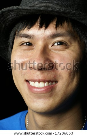 Happy asian chinese man with hat