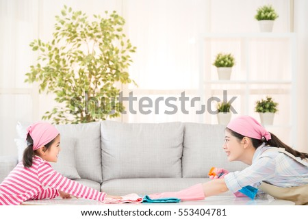 happy asian chinese mother and kids playing and cleaning living room together at home face to each other. housework and household concept.