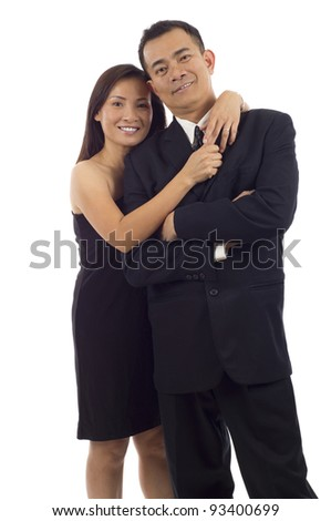 Happy Asian couple standing together isolated over white background - stock photo