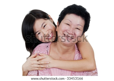 Happy Asian Family. Daughter hugging her mother.