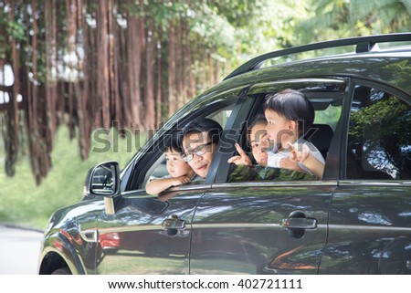 Happy Asian Family enjoy and do activity together in Car - stock photo