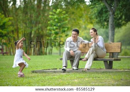 Happy Asian Family enjoying their time in the park - stock photo