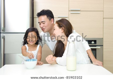 Happy Asian Family having breakfast together in the morning - stock photo