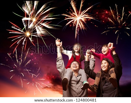 happy asian family looking fireworks - stock photo