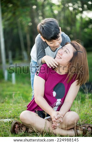 Happy Asian family ,mother with her son playing at park