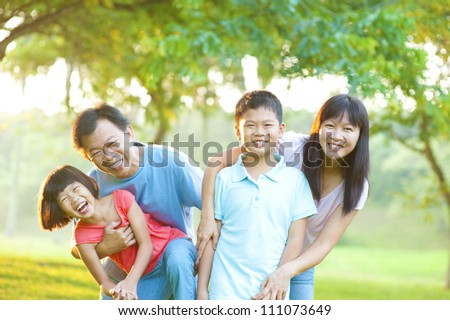 Happy Asian Family Outdoor Lifestyle - stock photo