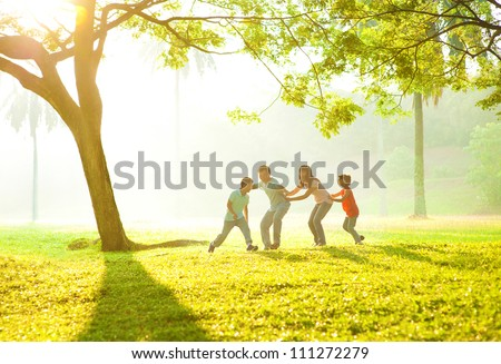 Happy Asian family playing together at outdoor park - stock photo