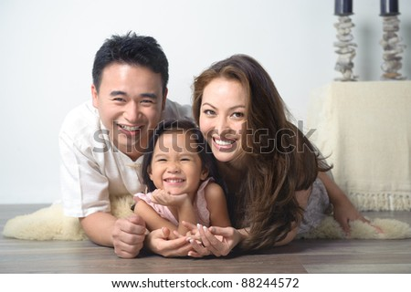 Happy Asian Family Smiling - stock photo