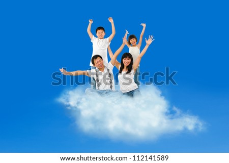 Happy Asian family traveling on cloud over blue sky - stock photo