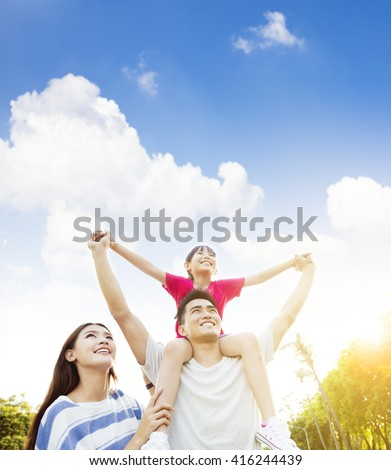 happy asian family with cloud background - stock photo