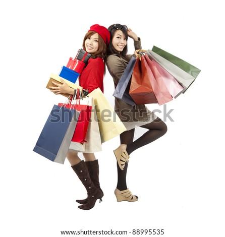 happy asian fashion girls holding shopping bag and gift box - stock photo