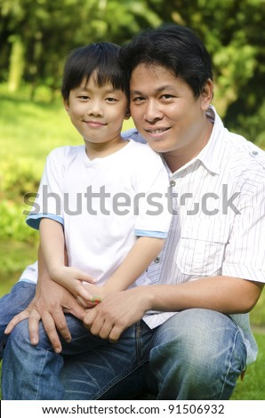 Happy Asian father and son - stock photo