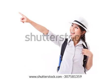 happy asian female traveler pointing up - stock photo