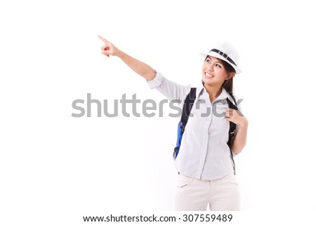 happy asian female traveller pointing up