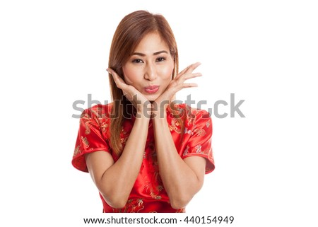 Happy Asian girl in chinese cheongsam dress on gray background