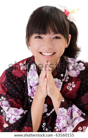Happy Asian girl praying and smiling with traditional japanese clothes. - stock photo