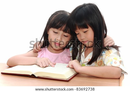 happy asian girl reading the book - stock photo