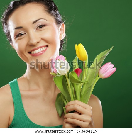 Happy asian girl with  tulips - stock photo