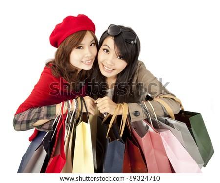 happy asian girls holding shopping bag - stock photo