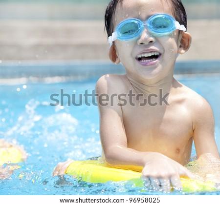 happy asian kid in Swimming Pool - stock photo