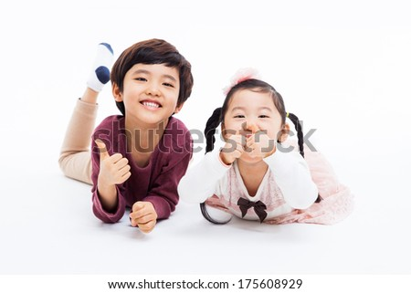 Happy Asian  kids showing thumb isolated on white background.  - stock photo