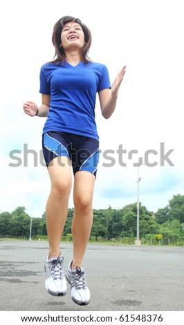 happy asian lady athlete in training - stock photo